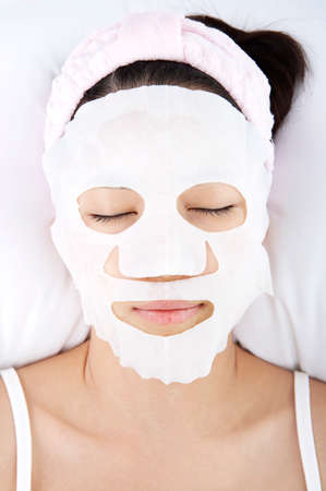leisureliness: Young woman receiving facial in spa, close up