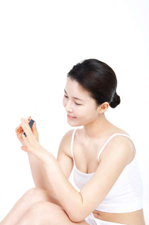 leisureliness: Young woman using nail buffer LANG_EVOIMAGES