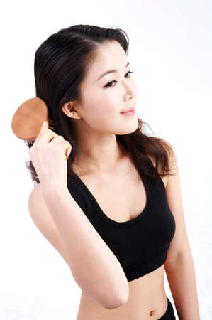 leisureliness: Young woman combing her hair