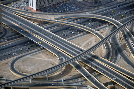 Crossing roads aerial view. Highway road. Expressway top view. Highway traffic. Multi-level road junction. Motorway. Top view freeway. Road architecture. Highway construction