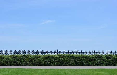 Metal fence on the coast, blue sky, sunny day