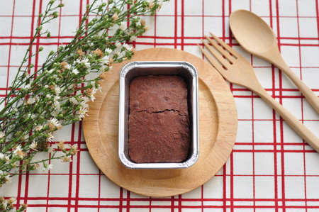 kinfolk: Brownie cake and flower Stock Photo