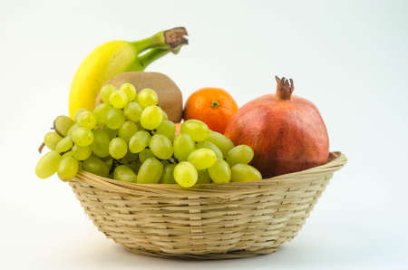 the basket: Fruits in a basket Stock Photo