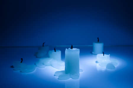 luminosity: Extinguished candles in blue Stock Photo