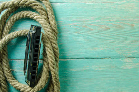 coiled rope: Harmonica lying on coiled rope