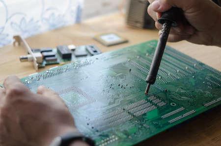 solder: Man solder chip Stock Photo