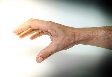 bangles hand: Human hand from the darkness to the light Stock Photo