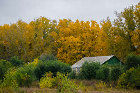 onset: The old house and the onset of autumn. Stock Photo