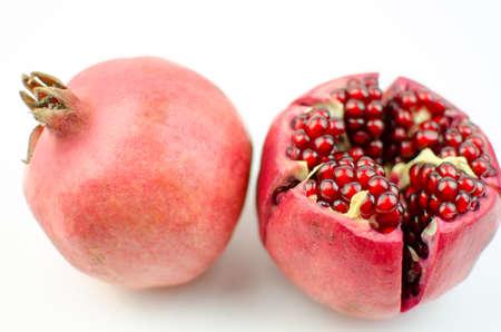garnets: Ripe sliced ??pomegranate. Stock Photo