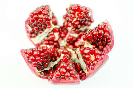 garnets: Ripe pomegranate open. Stock Photo