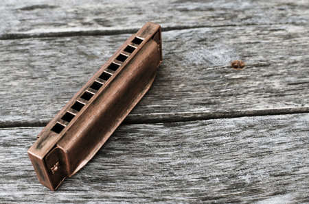 Harmonica on a wooden table