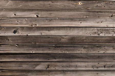 Horizontal background of old dried up grey planks