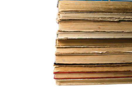 A stack of old books on white background