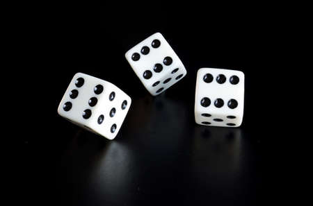 bad fortune: Thrown the dice on black background with reflection