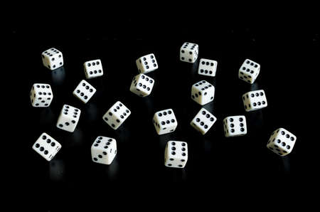 Thrown the dice on black background with reflection Reklamní fotografie - 81579526