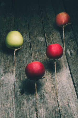 The apples are floating in the air on the background texture old wooden boards 版權商用圖片