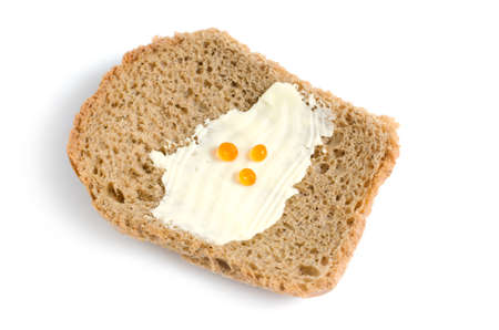 The poor slice of bread with a small amount of butter and red caviar on white background