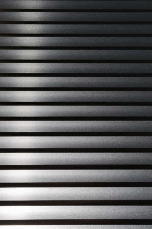 Abstract grey background of horizontal lines, blinds Фото со стока