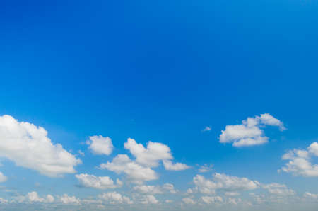White clouds on a blue sky background.Deterioration of weather conditions.
