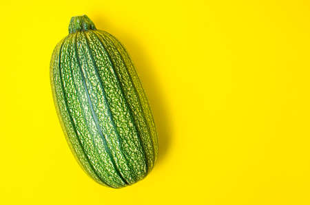 Zucchini on a yellow background, healthy green vegetables. Close up.