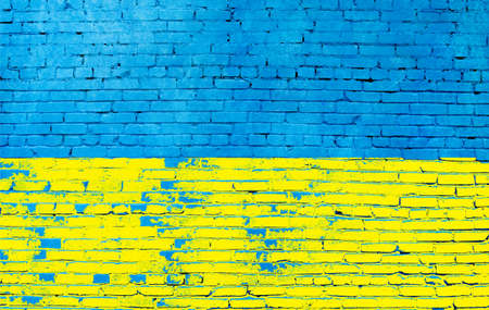 Brick wall painted in the colors of the Ukrainian flag.Close up.