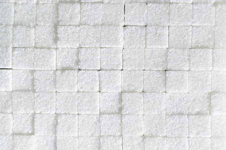 Background of refined sugar cubes.Sweet ingredient, food