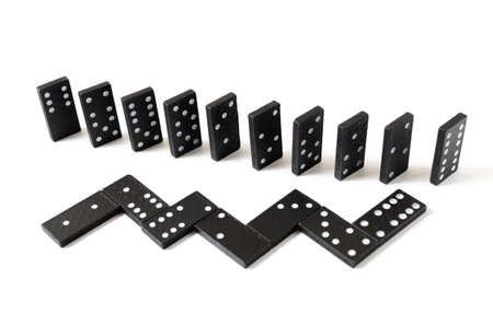 Black dominos on a white background.Board game, Hobbies and entertainment.