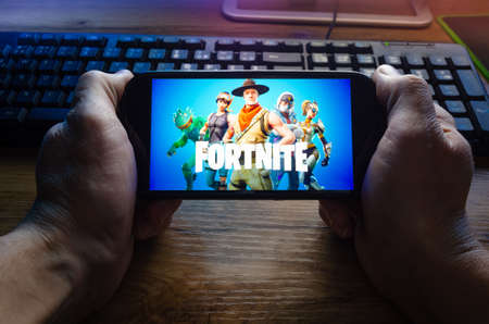 Kostanay, Kazakhstan, January 29, 2019.Person looks at the screen saver of the popular game Fortnite from Epic Games on Mobile.