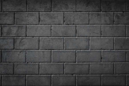 Background of smoothly laid cinder blocks. Wall of bricks with vignetting.