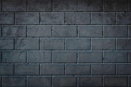 Sfondo di blocchi di calcestruzzo posati in modo uniforme. Muro di mattoni con vignettatura.