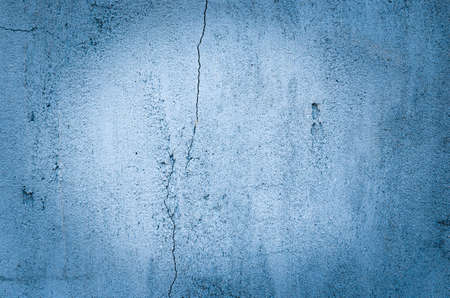 Background of blue casually superimposed concrete with vignetting. 스톡 콘텐츠