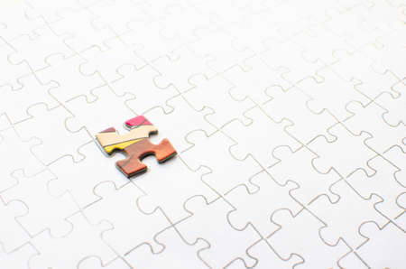 Assembled puzzle on a white background, highlight one of the red cells of the puzzle. 스톡 콘텐츠