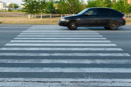 Car at high speed passes through a pedestrian Zebra.