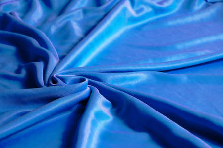 Texture, abstract background, silk blue fabric artistically laid out 版權商用圖片
