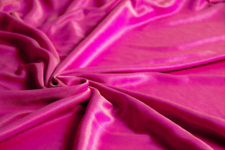Texture, abstract background, silk pink fabric artistically laid out