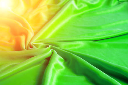 Texture, abstract background, silk green fabric artistically laid out