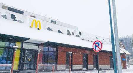 Kazakhstan, Kostanay McDonalds diner, severe snowstorm in winter. Sign Parking is prohibited