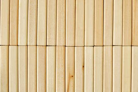 Background of wooden tightly folded rectangular bricks