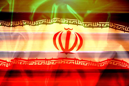 National flag of Iran on the background of a stack of books Reklamní fotografie