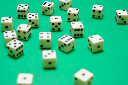 White dice on a green table in a casino Stok Fotoğraf
