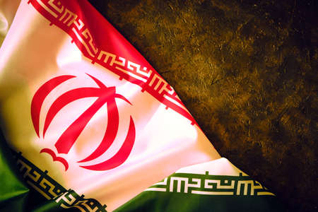 National flag of Iran on a dark background with space for text