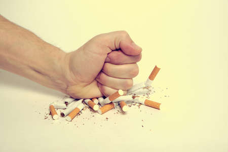 Man crushes cigarettes with his fist refusing to smoke