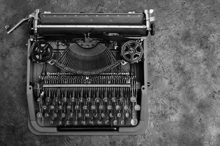 Old, vintage, typewriter in black and white image. The view from the top