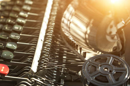Mechanism and keyboard of an old typewriter with a film coil. Bright sunlight