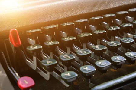Keyboard of a retro typewriter, illuminated by sunlight