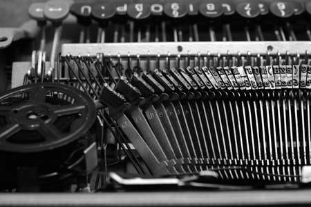 Mechanism and keyboard of an old typewriter with a film coil.In black and white image 版權商用圖片