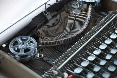 Mechanism and keyboard of an old typewriter with film coil 版權商用圖片