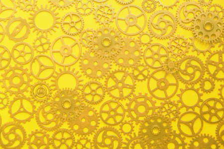 Background, an abstraction of a gear on a yellow background