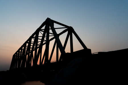 shadow silhouette: Silhouette, the railway bridge over the  river