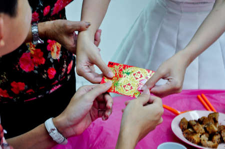 matchmaker: Giving angpau during Wedding Lunch Stock Photo